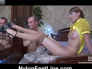 Slender-legged playgirl wears nylon tights and sexy spike heels for hard foot sex