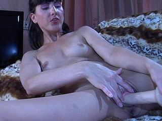 Bold chick shoves an oversized marital-device throughout her sheer crotchless hose