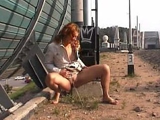 Nasty wench empties her bladder outdoors