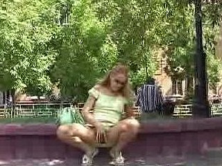 Fair chick widens her cookie in the park