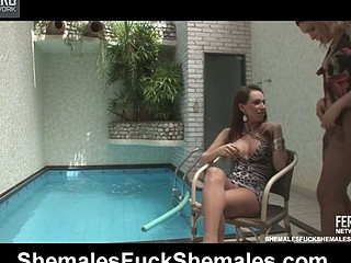 Wicked t-gals going wild in shemale-on-shemale action right by the pool