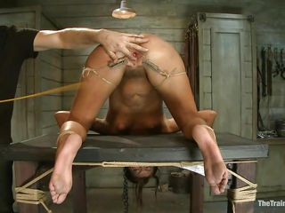 Her executor has a lot of experience when it's about naughty cunts like her. He shows where her place is and after he tied her on the table he gapes her cunt securing it with laundry pliers and rope. After her pussy is gaped he spanks her and humiliates her vagina just the way it deserves. Wonder what else he has in mind?