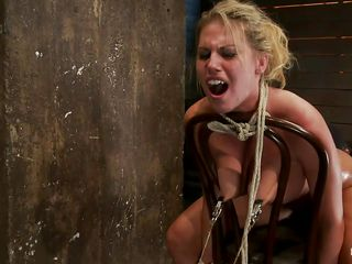 In order to make her stay with her head up, this guy inserted a big metal hook in her anus and tied it with a rope at her hair, now she stays the way he wants to and her position is perfect for a nice deep throat. She's all tied up on that chair and if she wants to move her head the hook will enter deeper in her anus, hurting..