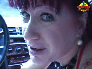 This mature redhead bitch is in her car on the road and she needs urgent to suck a cock and to feel the taste of the sperm on her tongue. Two guys stop their car and comes to Oriana car and the first thing she makes is to take guys dicks in her mouth. She offers a great blowjob to this guys.