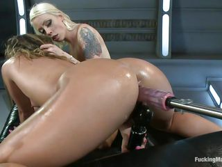 That blonde wants to give the other whore some pleasure and fingers her oiled anus while her pussy is drilled by the dildo attached on the machine. Her ass is being penetrated and that makes her mouth moan with pleasure, what a couple of naughty milfs and they do all that for us to watch.