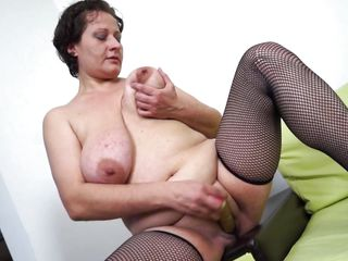 Short haired mature lady lady Melanie is always ready have a wet pussy. She is in her home alone, and wants to make her time count by enjoying a hell of a masturbation. In order to do so she is crushing her big boobs with one hand and at the same time inserting a dildo between her legs using her other hand.