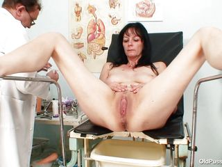 Mature brunette women with nice body and naughty breasts is sitting the gynecologist table completely naked with her legs spread so that her doctor can exam the vagina between them. He recommends her a dildo therapy so the treatment begins as he introduces that sex toy deep in her shaved vagina. She becomes horny and does..