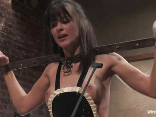 Cecilia Vega has a very hard to please boss in Princess Donna Dolore! Cecilia's hands are bound, she has big beads in her pussy attached to wires, and is getting her little titties whipped! They're as red as Princess Donna's dress! After some more whipping, she tells Cecilia to dust some more.