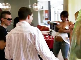 They are standing around a person lying on the table with cups on the breasts and they have applied the cream on the tits of the ebony girl and they are taking turn licking it off her and to picking up the cups and eating the cream. Everyone goes to shower afterwards to clean up.