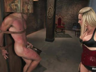 Mistress Harmony doesn't allows men to do what they want, so, with the help of her chains and all sorts of simple but efficient tools she punishes this muscled guy, first by adding clothespins on his face and then by spanking him while he's in chains. She does her job perfectly and soon this man will be obedient enough