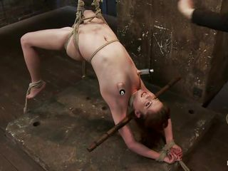 Wee all enjoy seeing a cute bitch getting what she deserves but this one receives a harsh treatment, her sexy oiled body is tied up and she's hanging while her executor uses a vibrator on her sweet cunt, fingering her pussy in the mean time. Her hot tits have suckers on them and her legs are spread granting full access to her..