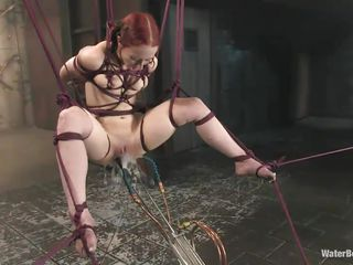 Sabrina Sparx, a young red head is tied up and is getting punished for cheating on her girlfriend. She is punished hard with her hands and legs tied up, she is bound & helpless while she gets sprayed with water on her pink cunt.