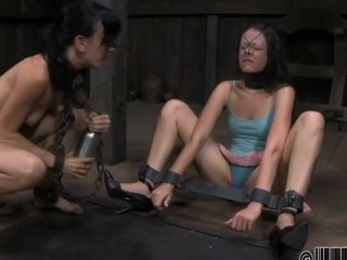 Restrained beauty is hoisted up for her sexy punishment