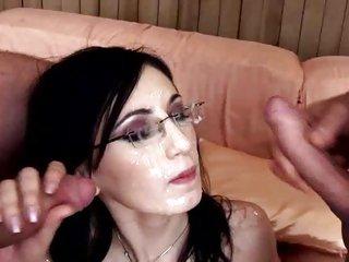 Raunchy Nora Davis gets her glasses splattered with cum