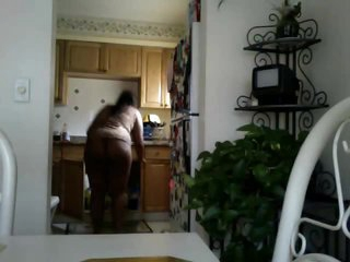 Black chick does the dishes in panties