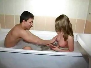 Young Couple Have Fun In Bathroom