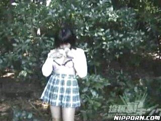 Japanese girl flashing and having a pee