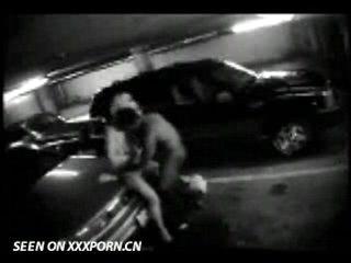 Couple caught on parkinglot cam