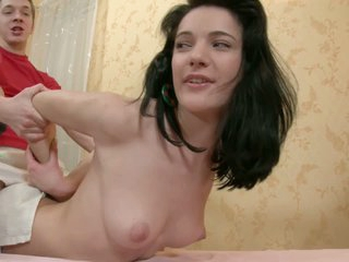 Black haired hottie Ronnie with sexy natural tits strips down to her panties to enjoy massage. She enjoys it with her face down. Young masseur is curious about her lovely ass.