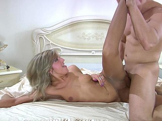 Luscious golden-haired getting her pantyhosed crotch eaten and splashed with cum
