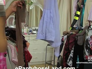Pretty chick holds a heap of various tights choosing tan ones for marital-device play