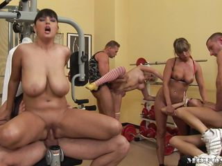 Everybody is busy in this gym, they like to work out hard but not the traditional way. These bitches are starting to sweat while the suck and ride cock. Check out those big boobs, shaved cunts and pretty faces. Probably we are going to see this training finishing with a few big loads of cum on these sluts