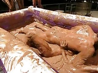 On today's episode you can see those lovely ladies dipping their gorgeous bodies in pudding in a wrestling contest. Watch their big tits bouncing around as they fight. Their shake their round asses from one side to another as they fight for the win. See the naked man trying to get a grip on them.