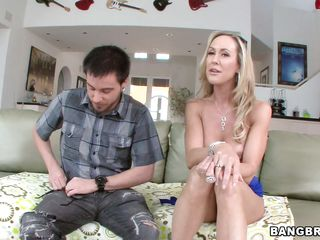 Brandi Love is sitting on the couch topless with a guy, then makes the conversation really interesting by leaning back and playing with herself, letting him take over. He gets his cock out and she eagerly sucks it, then lays back, opening her pussy to his tongue. He eats his milf with no cookies!