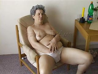 All she has is her denture and those white panties! Granny Rosa is fucking horny and she puts her hand under those panties to rub a saggy old pussy. Our granny uses what she can to satisfy her sex drive and this time it's a toilet pump. Well done granny, broach that pussy and give us a well deserved sight