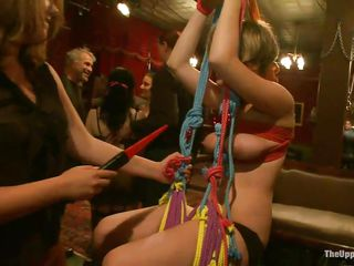 Watch this fetish party of bondage and role play. See these chicks with nice big boobs and asses getting tortured by the guys who loves to watch ladies in ropes! Look how the guy is slapping the redhead's busty tits as well getting her pussy fingered. Another whore is tied up and hanging from ceiling!