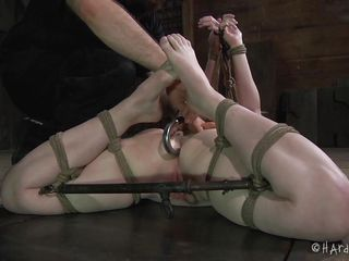 Mira Raine is tied up in the dungeon like a whore slave. She is whipped on her tied up tits. She has her legs spread and gets her pussy prodded by her master. She is humiliated and has her nipples pinched in a painful device.