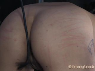 We take great pleasure seeing naughty sluts disciplined. Some of them require harsher treatments like this one. Her name is Siren and she was such a bad girl that her mistress putted her head in a cage and then spanked her shaved pussy without mercy. Her pussy then was gaped and rubbed with a vibrator.