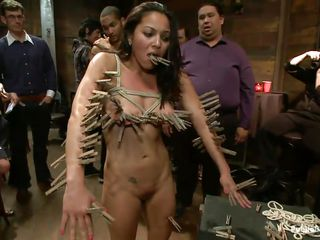 Adrian is a hot slut that needs attention and to be humiliated. The horny crowd uses her sexy body and does everything they want with her. She is tied, pulled by the hair and her cunt rubbed with a vibrator. Now the are using clothespins to make her suffer and when they are done people are taking picture of her
