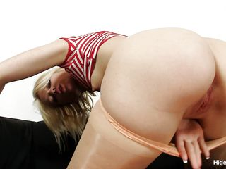 This blonde is feeling really hot and she also has a fetish for nylons. she took of everything, but never completely removed her nylon pantyhose. She is looking to please herself with her fingers as she plays with her pussy to make herself scream with expectation and pleasure.