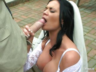 This busty bride takes a hard big cock in her mouth, sucking it with pleasure and rubbing it like a pro. Those big round boobs are asking for a huge load on them and she is helping this guy to cum on them by taking it between her breasts and then in her shaved vagina from behind. Watch the way she screams with pleasure, will..