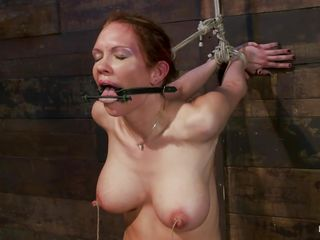 Those big boobs are delicious and perfect and after the guy fucks her pretty mouth he ties it and starts punishing those perfect breasts. First he uses some suckers so that her nipples will hardener and then, using a string, the executor ties her hard pink nipples and pulls them, leaving her in a stage of constant pain and..