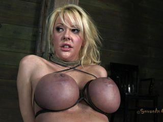 With her big boobs tied so hard that they've almost turned blue, Courtney awaits on the floor for her executor's attention. She doesn't need to wait to much because he's here and bends the slut on a chair with her breast up. Now the guy fucks her mouth and uses those big boobs as handles, that's cool.