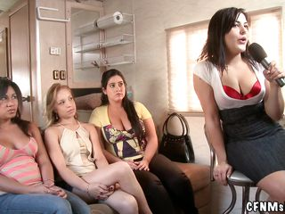 These cute milfs got together and it seems that they have some kind of meeting here, a meeting with a naked horny guy that is more then happy to fuck them without undressing these bitches. Using a microphone the bossy milf leads the action and she's the first who get's some action.