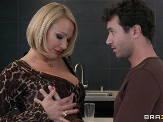 Mellanie Monroe asks James Deen if he's ever had an older woman before. He says that he hasn't, so she wants to give him that experience. She unleashes her massive mammaries for him to grab and suck on, then he gets his hand in her panties for a rub.