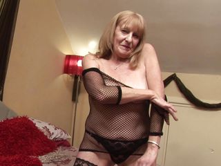 Hannah is a horny old lady who is playing with her body like a whore. See her undressing and showing her hot boobs to us. She squeeze those tits and then lies down to play with her pussy. She takes off her pantie and starts fingering her clitoris. After that she takes out a dildo to fuck herself hard!