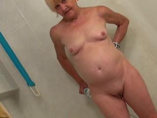 Old and juvenile woman masturbating and engulfing dick