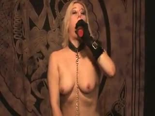Fetish girl in collar uses toys and pisses