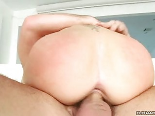 Busty brunette with tattooes gets butt pounded hard in bed