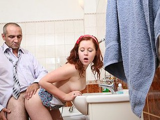 Succulent wet red-haired chick blowing and engulfing curly balls of an old horny prof.