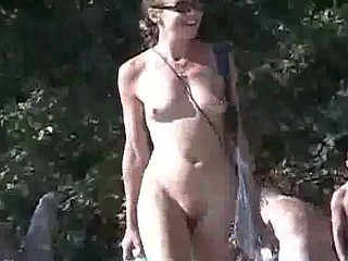 Some more footage of the nude sunseekers on Haulover Beach, hairy pussy, shaved pussy, hot totty in yellow bikini bottoms and a guy with a boner.