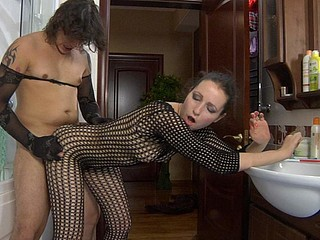 Teasing chick in a watch-thru bodystocking luring her guy into hose sex