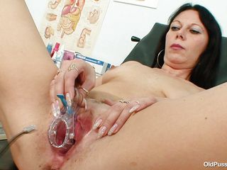 Brunette mature Magda is at her doctor for a vagina check up. Her doctor gapes that sweet shaved pussy and then uses a medical tool to gape her cunt so he can take samples after looking with attention using a flash light. We can see her insides but there's no trace of cum in there, perhaps the good old doc will take care of..