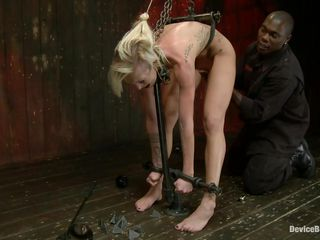 Does she likes being tied up real hard and humiliated? I think she does and her shaved sweet cunt asks for cock as she gets more and more excited. Her punishment is only going to get harsher as the black guy finger and slaps her butt from behind. In the next scene is is laid on her belly and her tied with leather strains. Does..