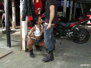 A very hot black model poses in front of a motorcycle showing us her body and touching herself. When the  photographer comes and offers to pay her  she refuses the money and gets down on her knees and starts sucking his white dick. Will she suck his dick until she receives his hot sperm over her face.