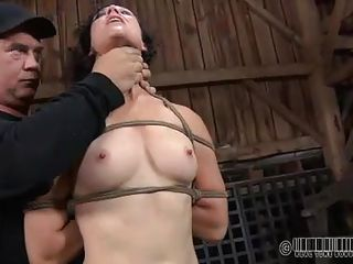 From hanging she ends up down on her knees. These two older men know their job and they subjugate her step by step. The milf obeys like a good whore and remains naked and knelt, opening her mouth for cock. What else they will do with her and how rough the humiliation will be is for us to see.